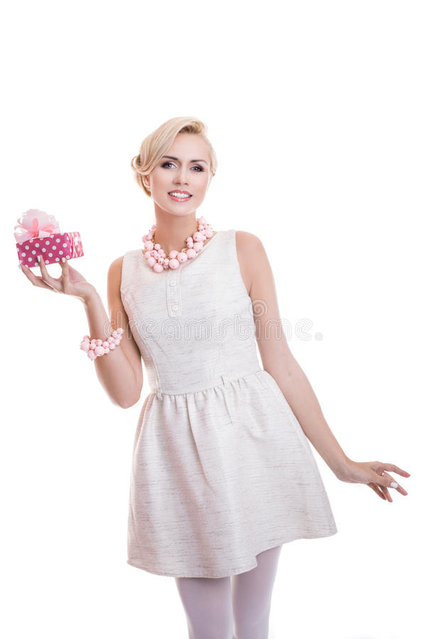 Happy beautiful woman holding small gift box with ribbon. Elegant lady. Happy blonde woman holding small gift box with ribbon. Elegant lady. Studio portrait stock images