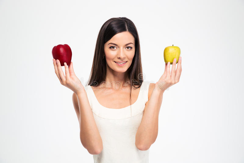 Happy beautiful woman holding two apples stock image