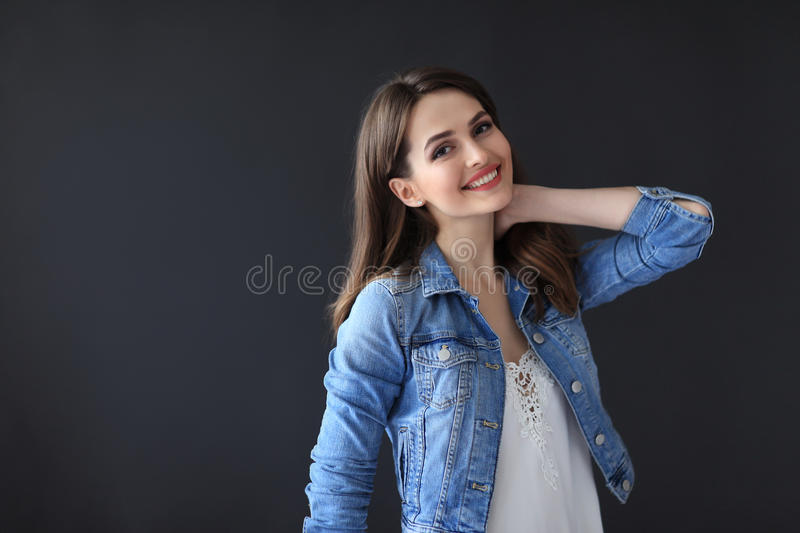 Happy beautiful woman portrait on dark background royalty free stock photos