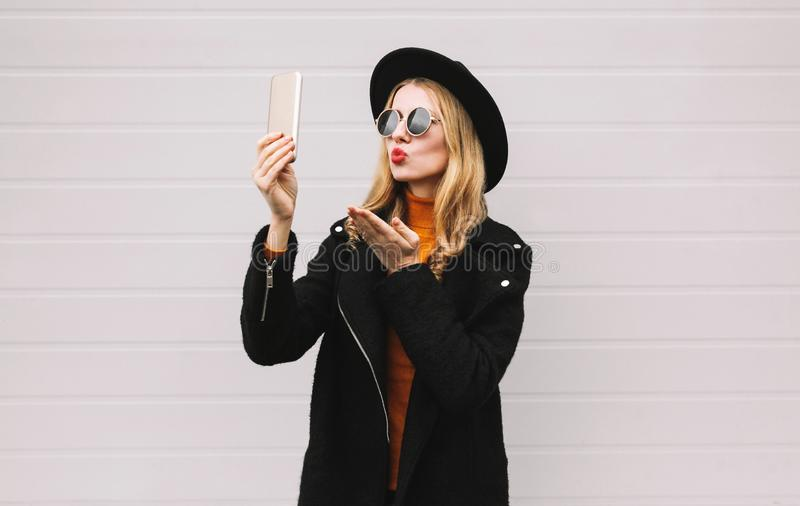 happy beautiful woman taking selfie picture by smartphone stock photo