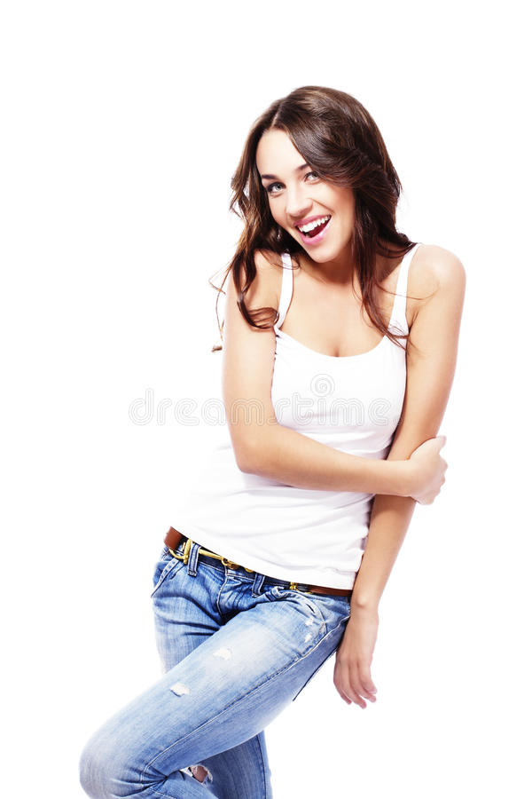 Happy beautiful woman wearing blue jeans holding h stock photography