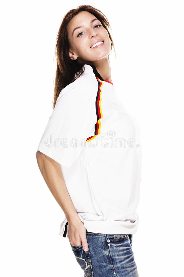 Happy beautiful woman wearing football shirt with royalty free stock photos