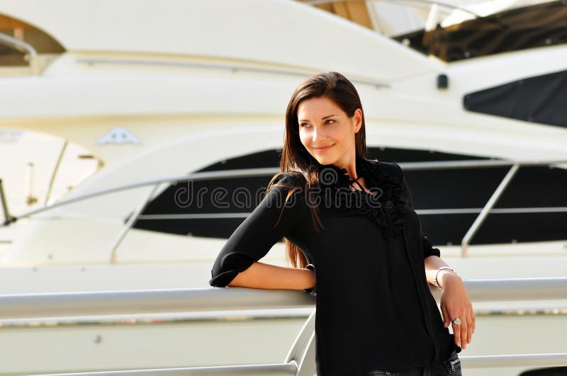 Happy Beautiful Woman In Yacht Club Stock Photo