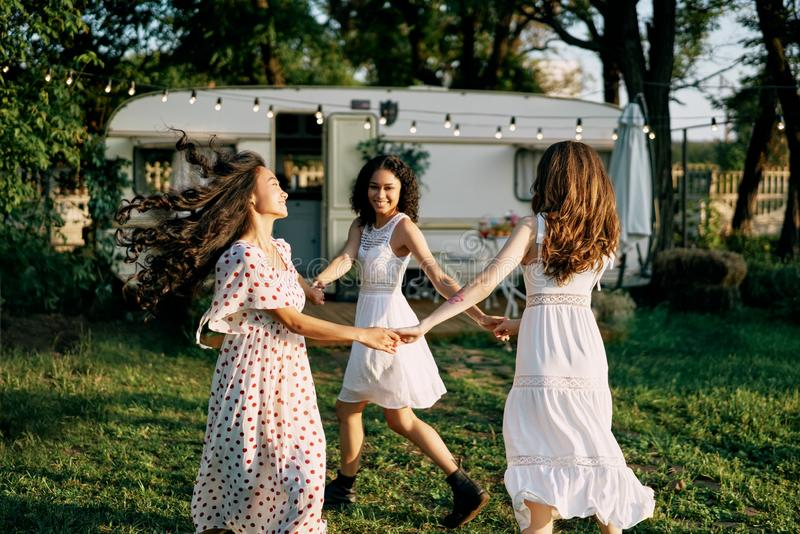 Happy beautiful women dancing outdoors on picnic royalty free stock photos