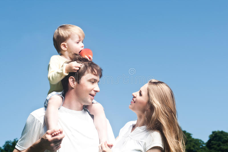 Download Happy Beautiful Young Family Posing Outdoors. Stock Photos - Image: 25439603