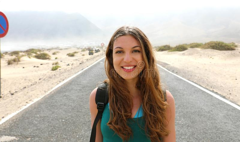 Happy beautiful young woman traveling backpacker adventure on th stock image