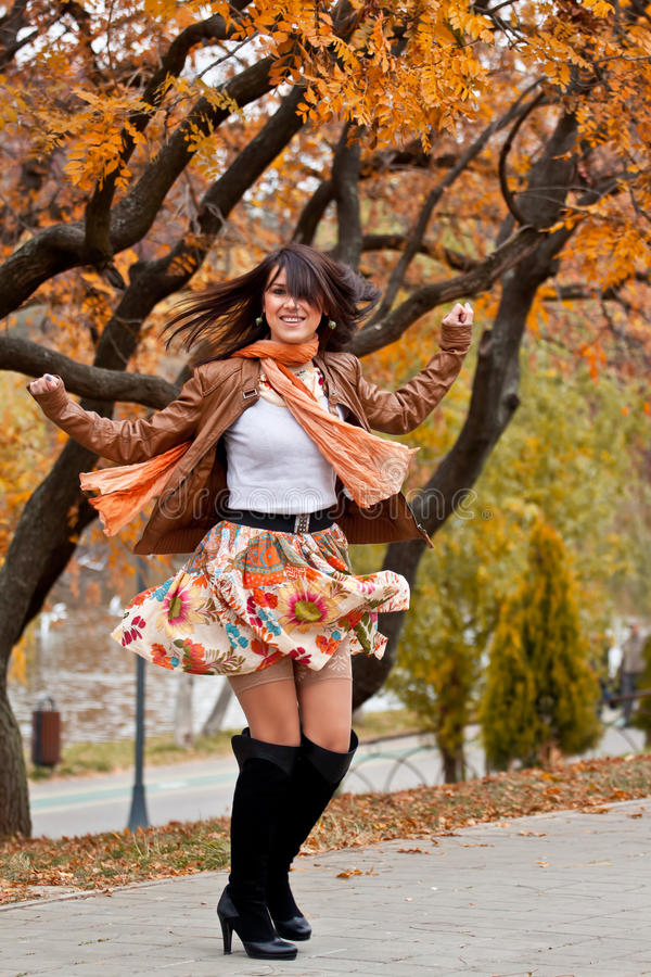 Happy beautiful young woman turning around royalty free stock image