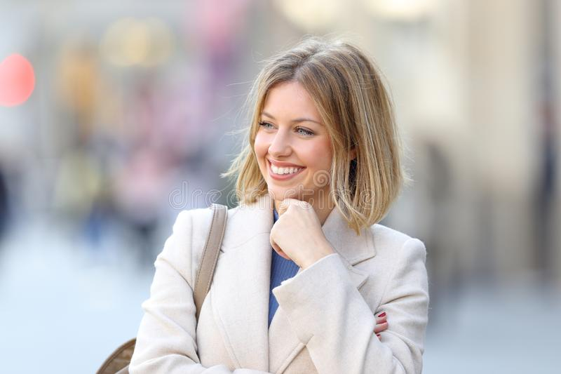Happy beauty woman looking at side in winter. Happy beauty woman looking at side in the street in winter royalty free stock photography