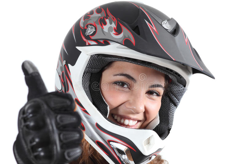 Happy Biker Woman With A Motocross Helmet And Thumb Up Royalty Free Stock Image