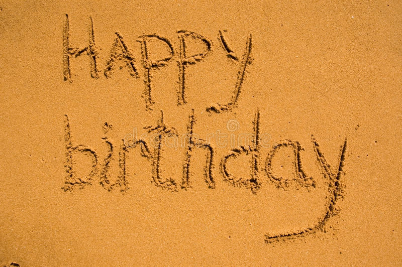 Happy birthday. In the sand royalty free stock image