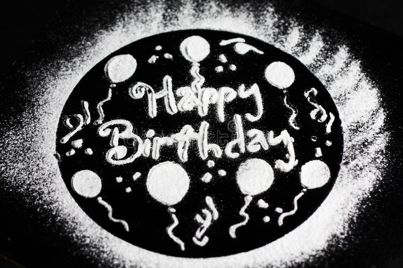 Happy birthday. With powdered sugar and baking tools royalty free stock photos