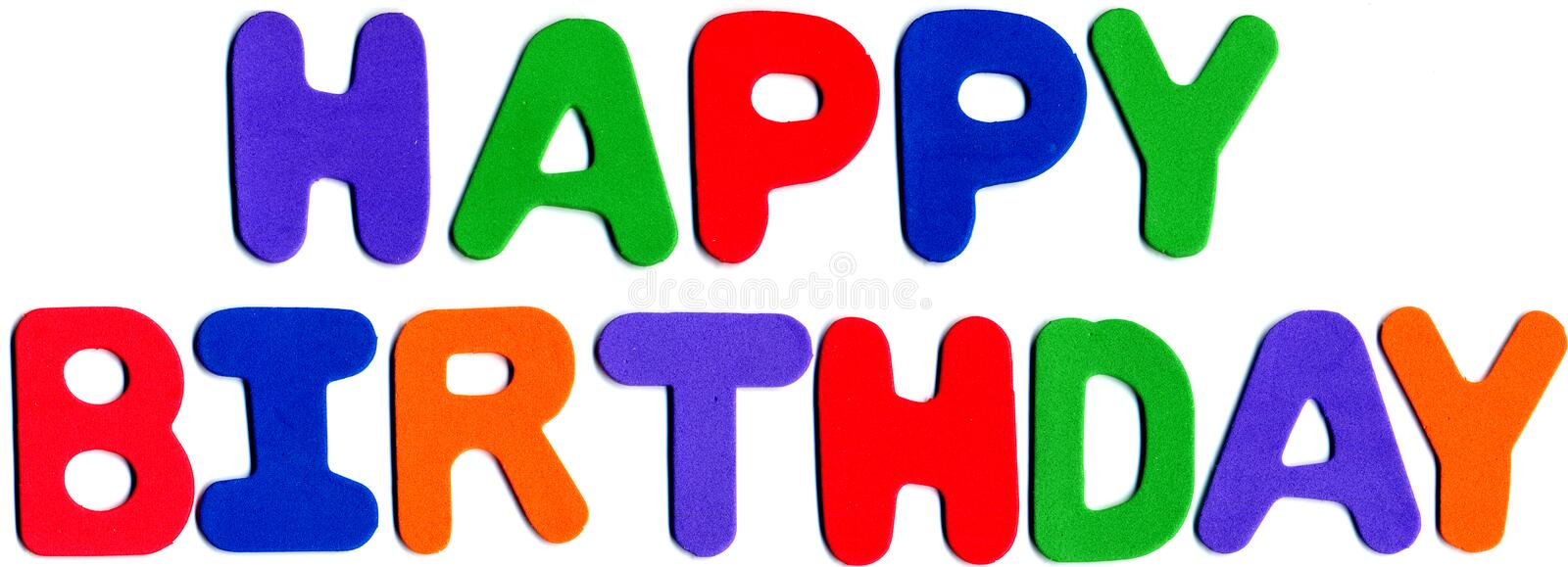 Happy birthday. Foam letters spelling happy birthday in varied colors stock images