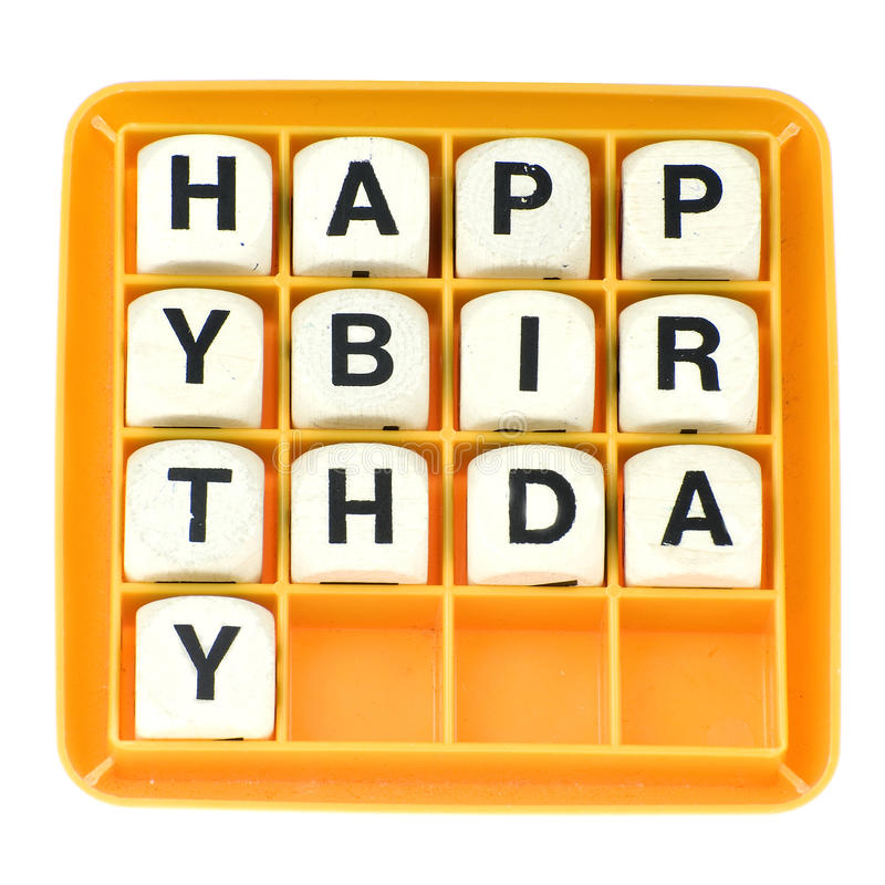 Happy Birthday. A lot of old dices with letters spell out happy birthday stock photo