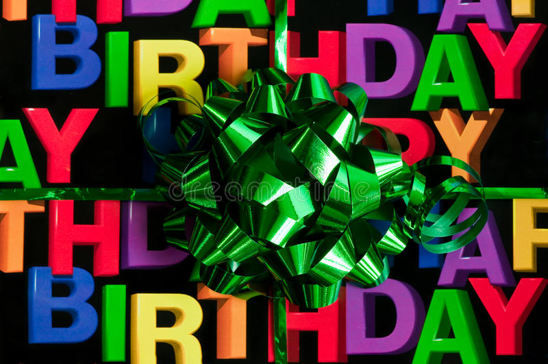 Happy birthday. A green ribbon with happy birthday in the background stock photography