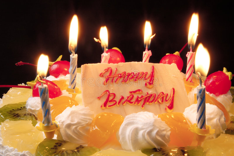 Happy Birthday Cake. Close-up of birthday cake lighted with burning candles royalty free stock photo
