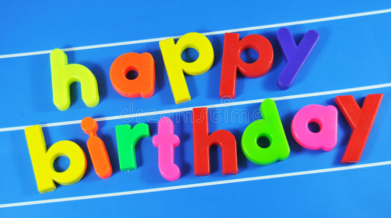 Happy Birthday!. Happy birthday colorful message on magnetic blue board stock photos