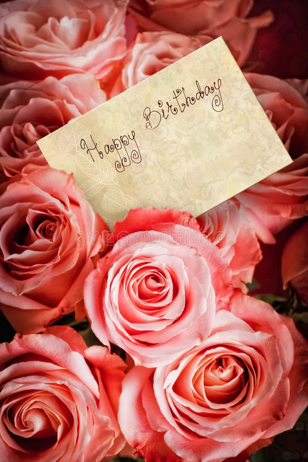 Happy Birthday. Bouquet of pink roses with a greeting card with text: 'Happy Birthday stock image