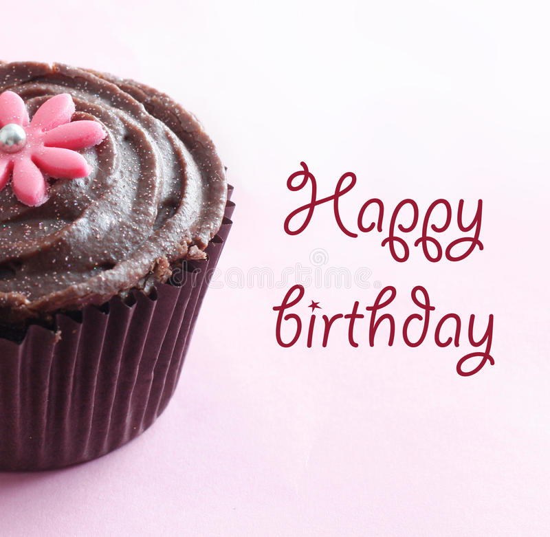 Happy birthday. Cake muffin on pink bg royalty free stock images