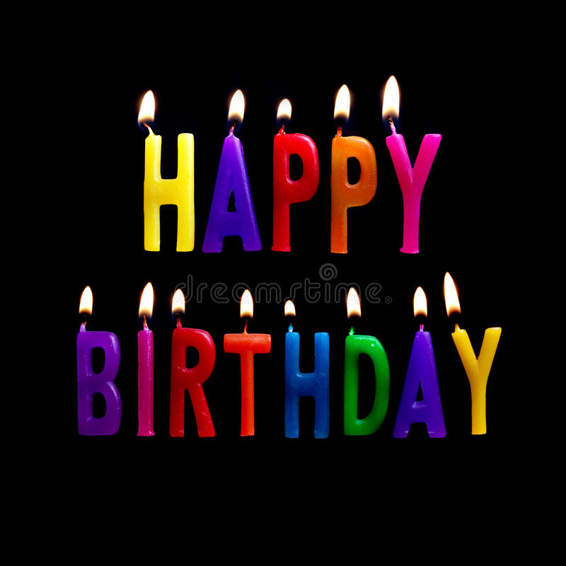 Happy Birthday. Candles spelling out happy birthday on a black background stock photography