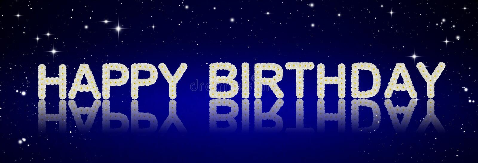 Happy Birthday. Made from tropical flowers on night sky background stock photography