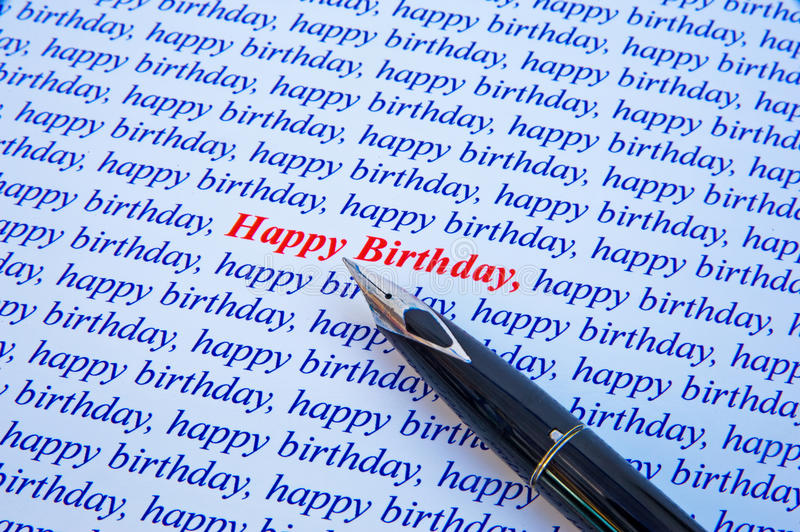 Happy Birthday. A macro image of a happy birthday message, made of repeated use of the message in blue text but emphasized by one example in bold red color royalty free stock image