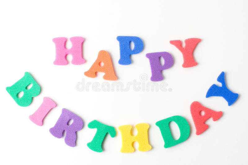Happy Birthday. Text happy birthday formed with kids foam letters stock photo