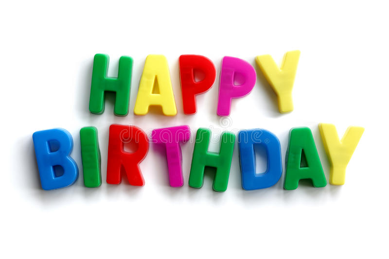 Happy birthday. Words made from colourful letter magnets on white background royalty free stock photography