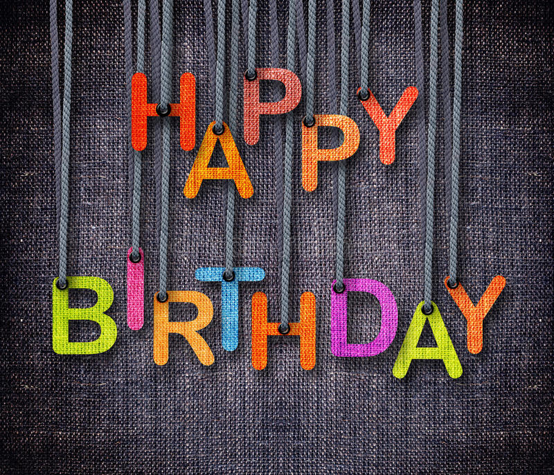 Happy Birthday. Hunging by rope as puppeteer on sackcloth background royalty free stock photos
