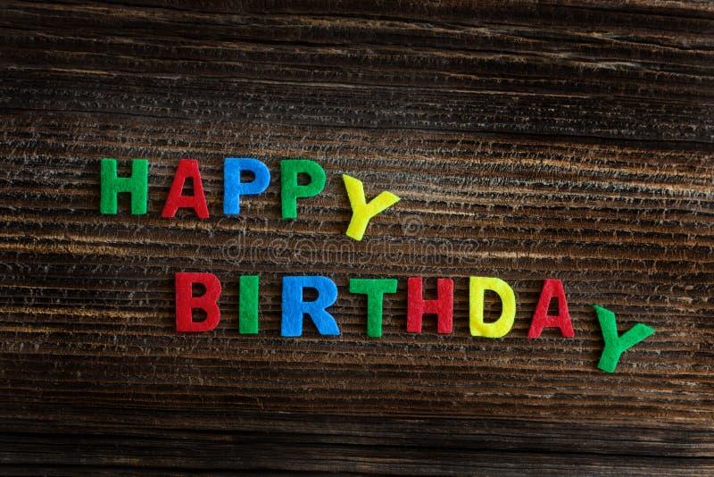 Happy birthday. On wooden board stock image