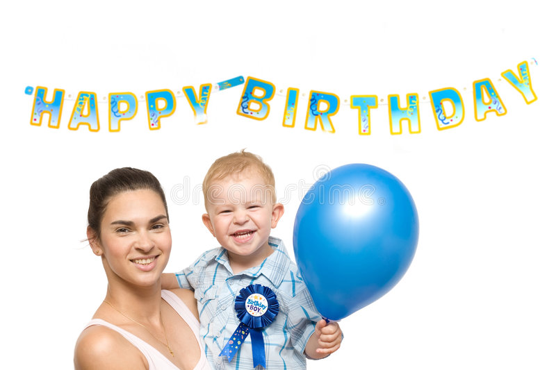 Happy Birthday. Two years old baby boy and mother together in front of a Happy Birthday sign stock images