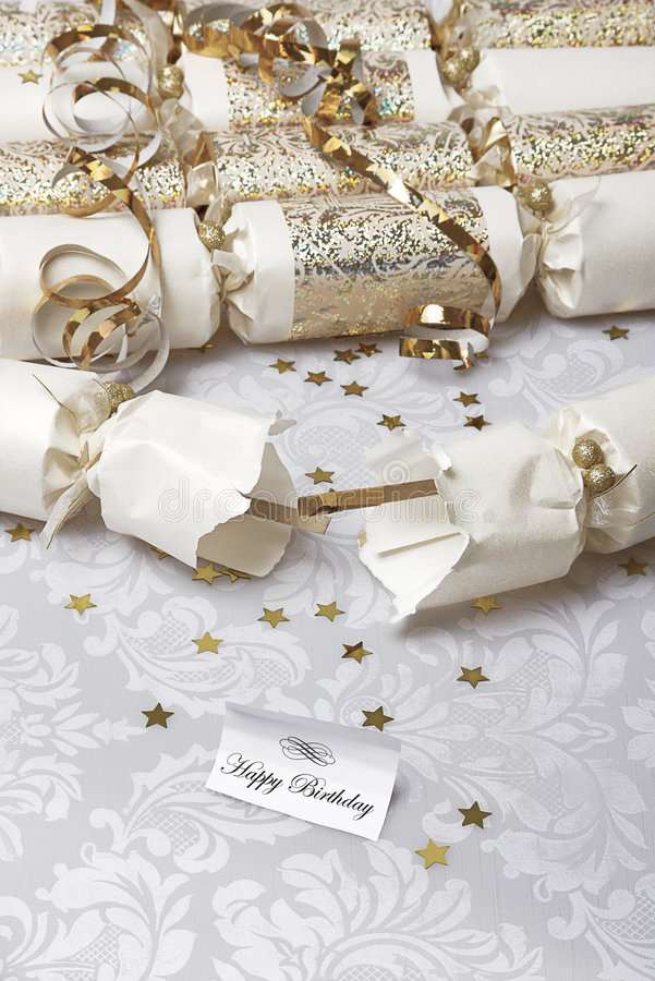 Happy birthday. Festive party crackers with a happy birthday note royalty free stock photos