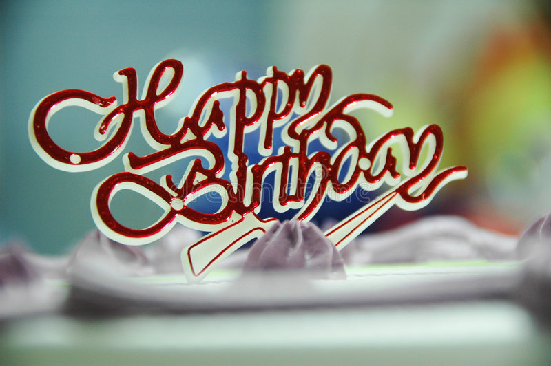 Happy Birthday. A birthday cake decorated with white and purple cream stock image