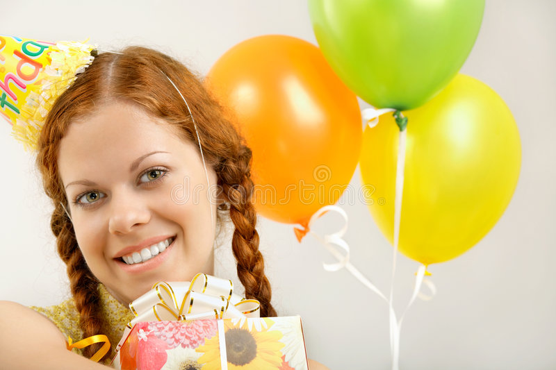 Happy birthday. Portrait of the happy birthday woman with gifts stock photo