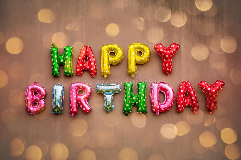 Happy Birthday alphabet text on wall background.  royalty free stock images