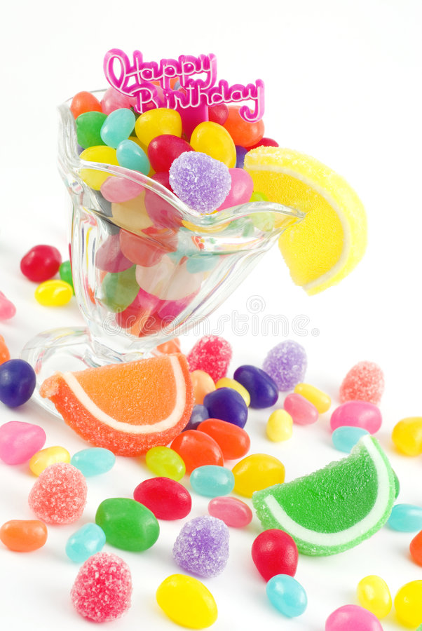 Happy Birthday with Assorted Candies. A glass parfait dish full of bright colored jelly beans and gumdrops with a Happy Birthday message, isolated on white, copy stock images