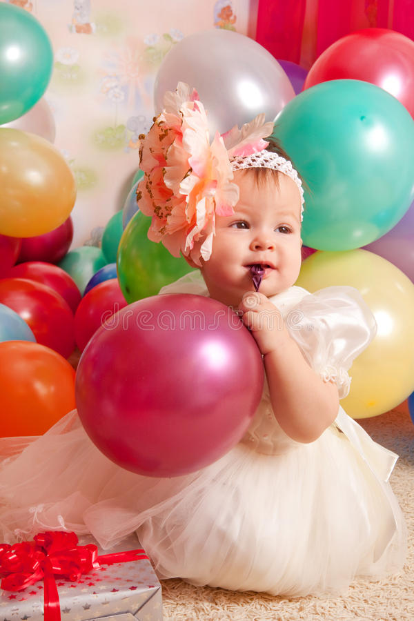 Happy birthday baby. Little girl with group ball. Play room royalty free stock image