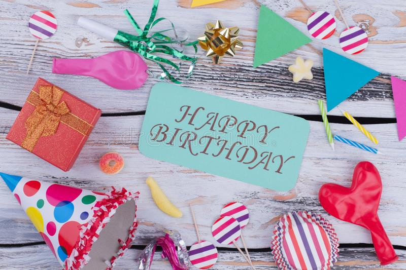 Happy Birthday background with colorful party supplies. royalty free stock photo