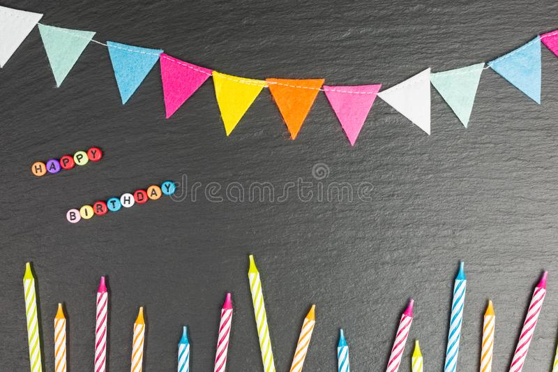 Happy birthday background. With colorful candles and felt bunting with copy space stock image