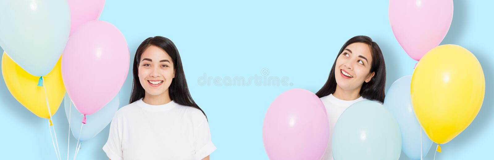 Happy birthday. Balloon party. Happy asian girl with balloons isolated on blue background. Copy space.  stock image
