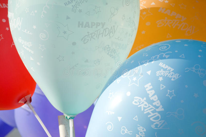 Happy birthday balloons. Colorful balloons with white sign happy birthday stock photography