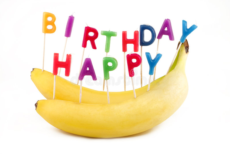Happy Birthday Bananas. Two yellow bananas with Happy Birthay Letter candles instead of cake for healthy lifestyle birthday, isolated with white background and royalty free stock images