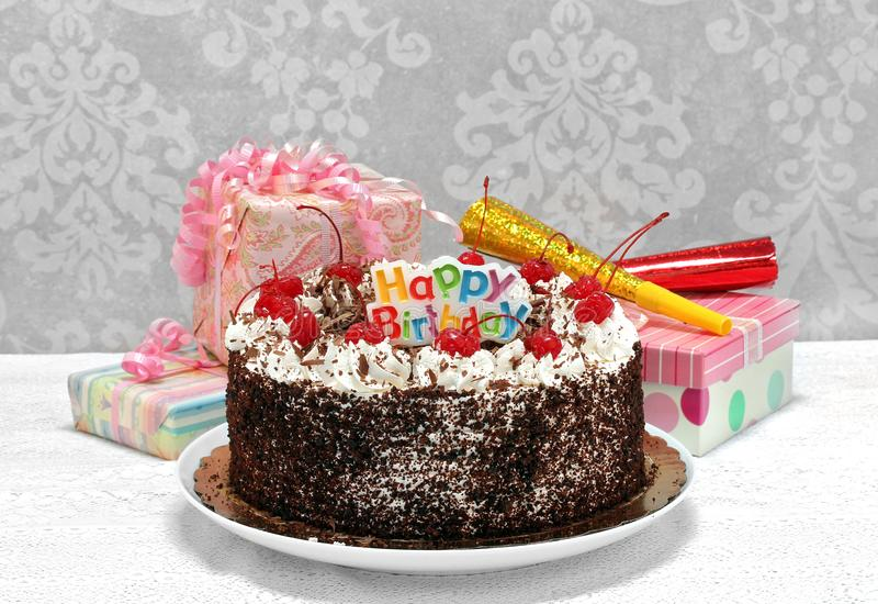 Happy Birthday Black Forest Chocolate Cake with gifts. stock photo
