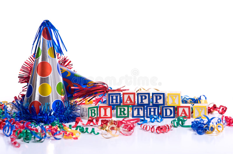 Happy Birthday Blocks. On a white background with copy space, including a party hat and streamers royalty free stock image