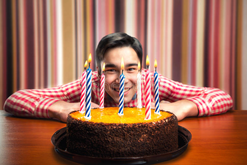 Happy birthday boy. With cake with candles in decorated room stock image