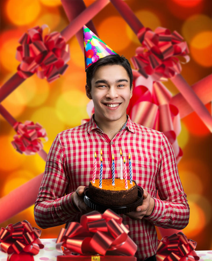 Happy birthday boy. Holding cake with candles stock image