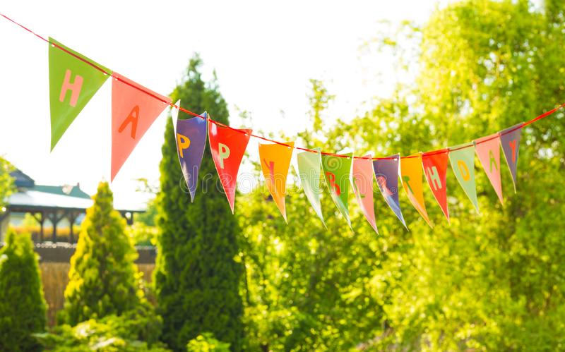 Happy Birthday bunting garland banner in the garden stock image