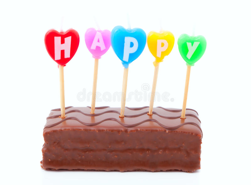 Happy birthday cake. Happy birthday candles on chocolate cake royalty free stock photography