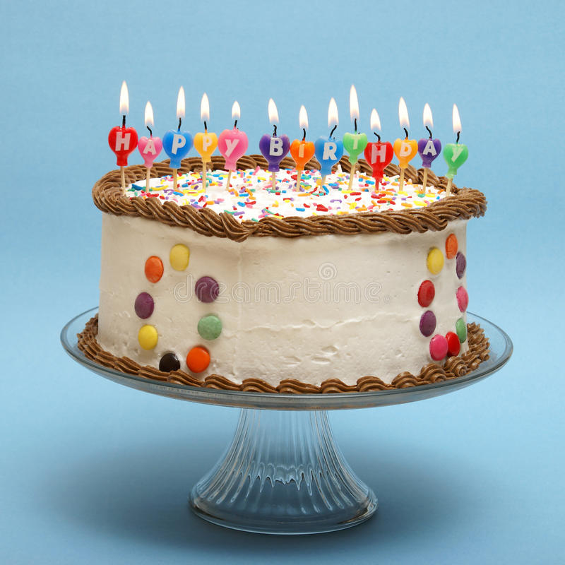Happy Birthday Cake. A cake and it's candles that read happy birthday royalty free stock photos