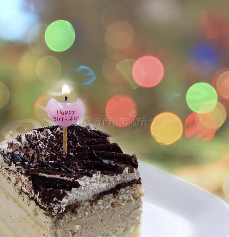 Happy birthday cake. With candle stock image