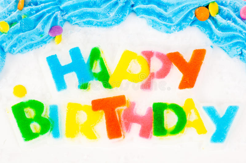 Happy Birthday cake. Happy Birthday lettering on an iced and decorated cake stock images